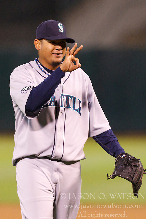 April 1, 2011; Oakland, CA, USA;  Seattle Mariners starting pitcher Felix Hernandez (34) celebrates after the game against the Oakland Athletics at Oakland-Alameda County Coliseum.  Seattle defeated Oakland 6-2.