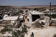 Destroyed residential area in Koreen after barrel bomb shelling.<br />