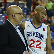 Delaware 87ers Head Coach Rod Baker comforts Delaware 87ers Forward Rodney Williams (22) in the course of the second half of a NBA D-league regular season basketball game between the Delaware 87ers (76ers) and the Erie BayHawks (Knicks) Friday, March. 28, 2014 at The Bob Carpenter Sports Convocation Center in Newark, DEL