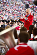 UW Marching Band Director Michael Leckrone conducts during the University of Wisconsin-Madison commencement ceremony at Camp Randall Stadium, Saturday, May 17, 2014.
