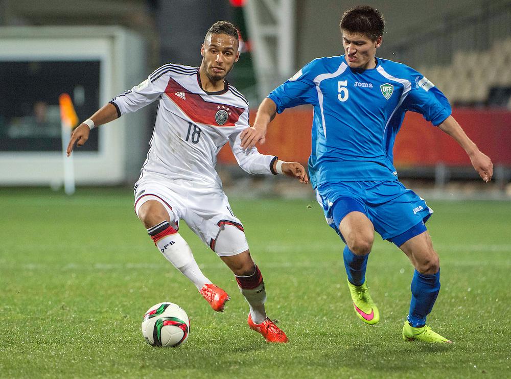 Hany Mukhtar, left, of Germany and Odiljon Hamrobekov of Uzbekistan in the Under 20 soccer World Cup match, Christchurch, New Zealand, Thursday, June 04, 2015. Credit:SNPA / David Alexander