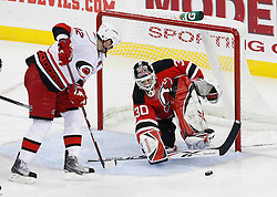 Apr 23, 2009; Newark, NJ, USA; New Jersey Devils goalie Martin Brodeur (30) makes a save against Carolina Hurricanes center Eric Staal (12) during the third period of game five of the eastern conference quarterfinals of the 2009 Stanley Cup playoffs at the Prudential Center. The Devils beat the Hurricanes 1-0 to take a 3-2 lead in the best of 7 series.