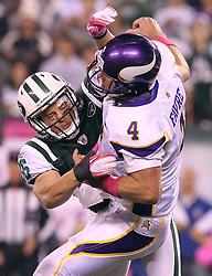 Oct 11, 2010; East Rutherford, NJ, USA; New York Jets safety Jim Leonhard (36) hits Minnesota Vikings quarterback Brett Favre (4) during the first half at the New Meadowlands Stadium.