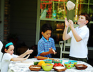 (left to right) Siblings Lucy, 5, Sam, 9, and Patrick Sherman, 11, prepare their pizza dough for the grill.