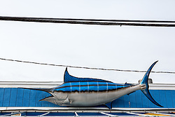 decorative swordfish on the side of a building in Montauk, NY with powerlines