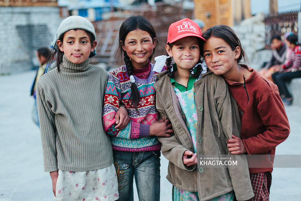 Kids of Chitkul village posing for the camera .