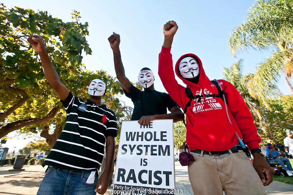 Protesters march through out South Los Angeles in response to the not guilty verdicts in the Trayvon Martin verdict in Florida.