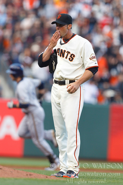 July 23, 2011; San Francisco, CA, USA;  San Francisco Giants starting pitcher Ryan Vogelsong (32) reacts after giving up a home run to Milwaukee Brewers left fielder Ryan Braun (back) during the fourth inning at AT&T Park.