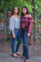 Calistoga high school students Vitoria Montanez and Jasmin Romero wait outside the Quinceanera celebration at the Napa Fairgrounds in Calistoga.