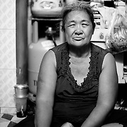 Hoang Thi Dao, 65 years old, Ho Chi Minh City, Vietnam. Dao earns her living since more than 20 years by picking through the garbage in the cities Go Vap district and selling everything that is possible to recycle. With this she makes around 20.000 VND (around 1 USD) per night. She takes care of her two granddaughters Truc and Cuc (12 years old).