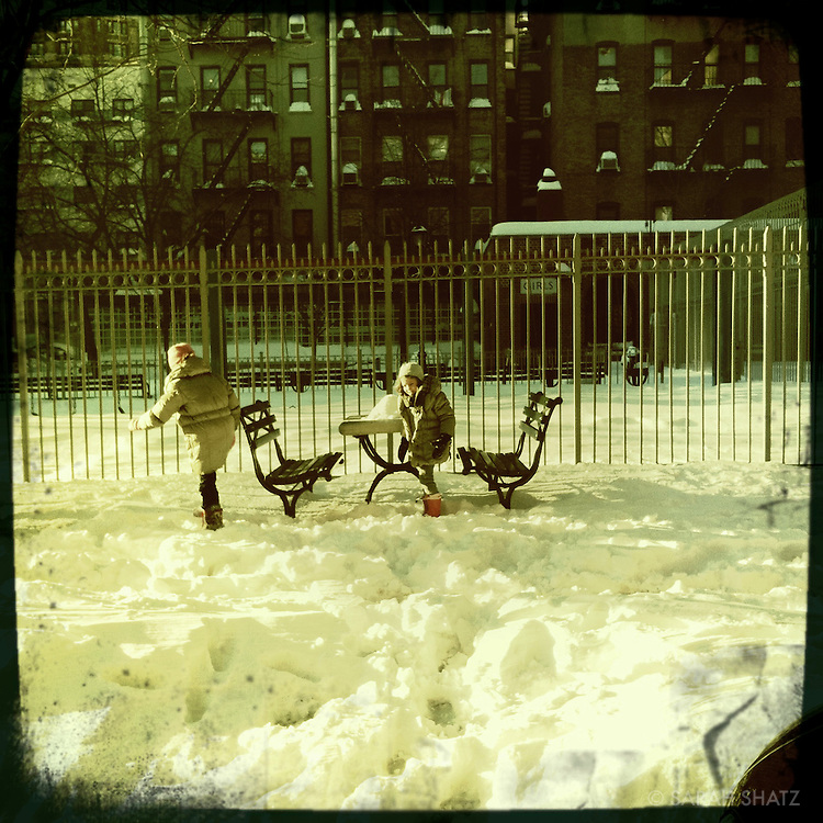 Girls playing in snow, Thompson Street