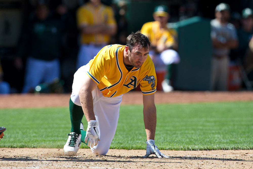 OAKLAND, CA - APRIL 27: Adam Rosales #17 of the Oakland Athletics reacts after getting hit in the head by a pitch from Pedro Strop #47 of the Baltimore Orioles (not pictured) during the ninth inning at O.co Coliseum on April 27, 2013 in Oakland, California. The Baltimore Orioles defeated the Oakland Athletics 7-3. (Photo by Jason O. Watson/Getty Images) *** Local Caption *** Adam Rosales