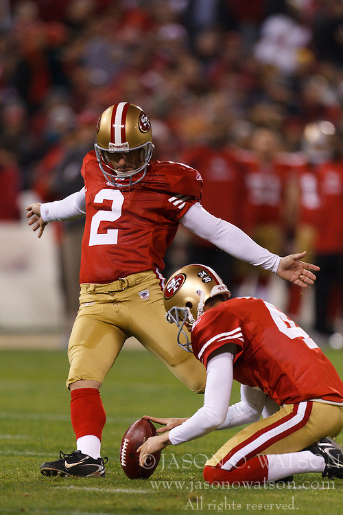 Dec 19, 2011; San Francisco, CA, USA; San Francisco 49ers kicker David Akers (2) kicks a field goal off the hold from punter Andy Lee (4) during the second quarter against the Pittsburgh Steelers at Candlestick Park. Mandatory Credit: Jason O. Watson-US PRESSWIRE