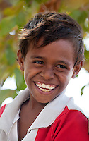 Portrait of a Timorese boy smiling, Dili, East Timor