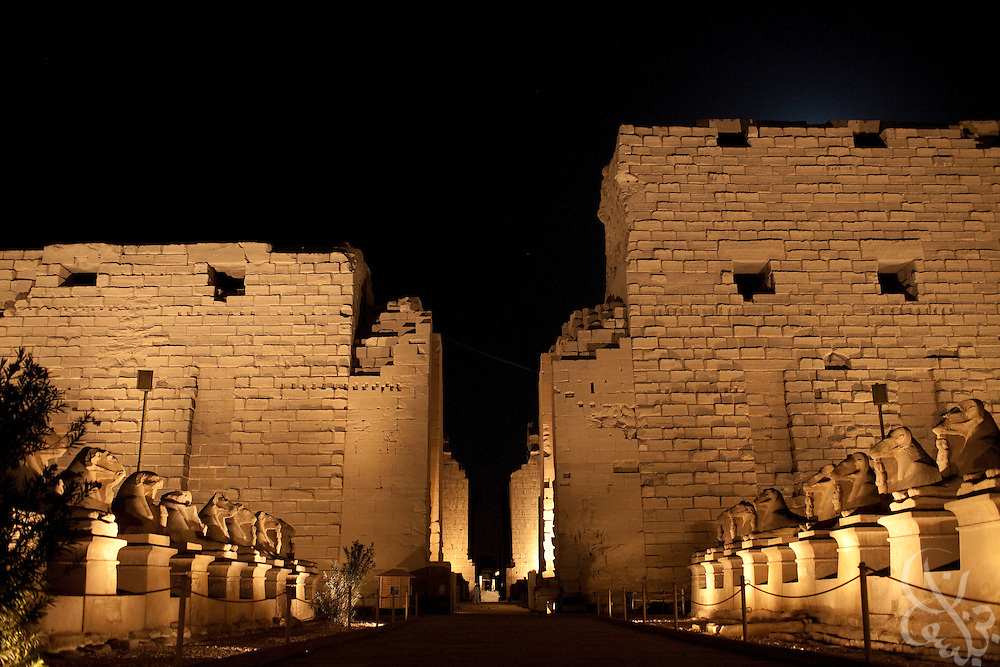 The palace complex at Karnak is illuminated by colored lights as part of a tourist sound and light show June 6, 2009 near Luxor, Egypt. Local officials have embarked on a 30 year redevelopment plan in Luxor and the surrounding area that will cost an estimated total of 5 billion Egyptian pounds (nearly 200 million US dollars.) The plan calls for redevelopment of local infrastructure and improved access access and increased protection of the areas famed ancient archeological marvels. (Photo by Scott Nelson)