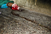 The trail of the bloodmark as the victim, who had died of head injury, was dragged into the mortuary. Image © Balaji Maheshwar/Falcon Photo Agency