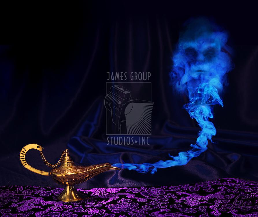 maagic Aladdin genie lamp with genie arising from blue smoke