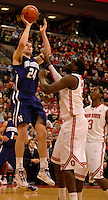 John Shurna #24 of the Northwestern Wildcats puts up a shot over Evan Ravenel #30 of the Ohio State Buckeyes during the first half of an NCAA college basketball game on Dec. 28, 2011 at Value City Arena in Columbus, Ohio.
