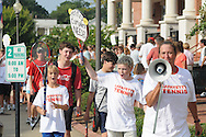 Supporters of a bond issue for new tennis courts in Oxford, Miss. walk around the Lafayette County Chancery Building on Wednesday, August 25, 2010.