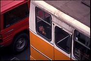 A boy sleeps on a public transit bus in Santiago, Chile.