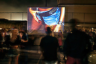 """Projection of the photographic series """"Rio Baile Funk"""" during a Baile, here in the favela Boca do Mato, Northern area of Rio de Janeiro. After years documenting and photographing  the bailes funk, it seemed only fair to show this work where it actually took place.."""
