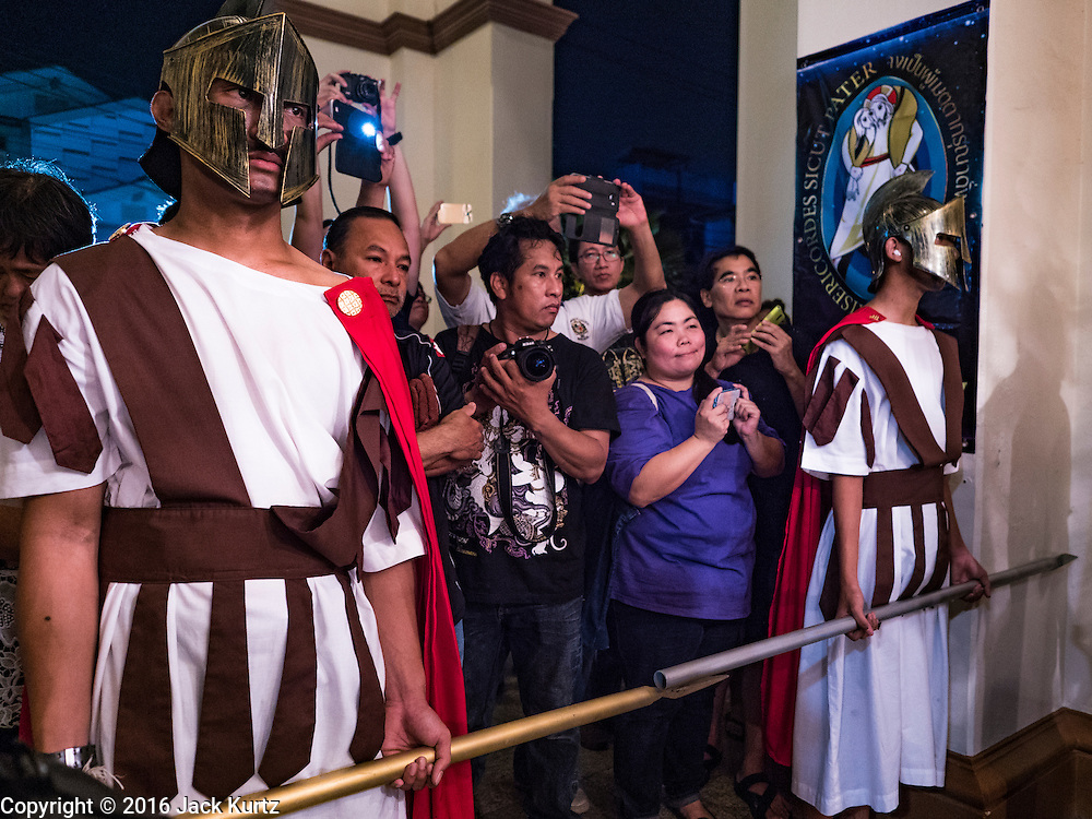 25 MARCH 2016 - BANGKOK, THAILAND:  Men dressed as Roman soldiers hold back the crowd during Good Friday observances at Santa Cruz Church in Bangkok. Santa Cruz was one of the first Catholic churches established in Bangkok. It was built in the late 1700s by Portuguese soldiers allied with King Taksin the Great in his battles against the Burmese who invaded Thailand (then Siam). There are about 300,000 Catholics in Thailand, in 10 dioceses with 436 parishes. Good Friday marks the day Jesus Christ was crucified by the Romans and is one of the most important days in Catholicism and Christianity.     PHOTO BY JACK KURTZ