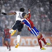 SHOT 3/22/13 7:46:16 PM - The United State's Jermaine Jones #13 goes up for a head ball with Costa Rica's Christian Gamboa #2 during their World Cup qualifying game at Dick's Sporting Goods Park in Commerce City, Co. on Friday March 22, 2013. The U.S. won the game 1-0 in a spring blizzard that blanketed the pitch and stadium in snow. (Photo by Marc Piscotty / © 2013).