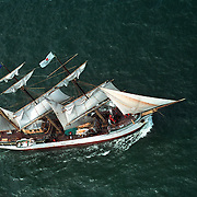 Aerial view: Sailing ship Picton Castle under way during Operation Sail between Lynhaven & Ft Monroe Hampton Roads, Virginia. Chesapeake Bay Region.