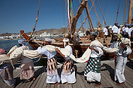"""16th February 2010. Muscat. Oman..Pictures of """"The Jewel of Muscat"""" departure ceremony. Traditional Omani drummers perform and load the yacht prior to departing the port of Mutrah and Oman. The project have built a replica yacht with traditional methods and are recreating the origanol historic journey too Singapore."""