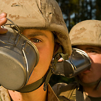 Marine Corps recruits Sean Flury and Shawn Hopson drink soup from their canteens at Parris Island, S.C., on Nov. 24, 2007. (Photo by Stacy L. Pearsall)