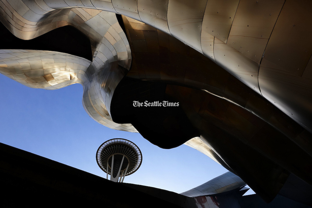 Seattle's most widely known architectural icon, the Space Needle, peeks between the tracks of the monorail and the undulating metal sides of the EMP, which has become an icon in its own right.
