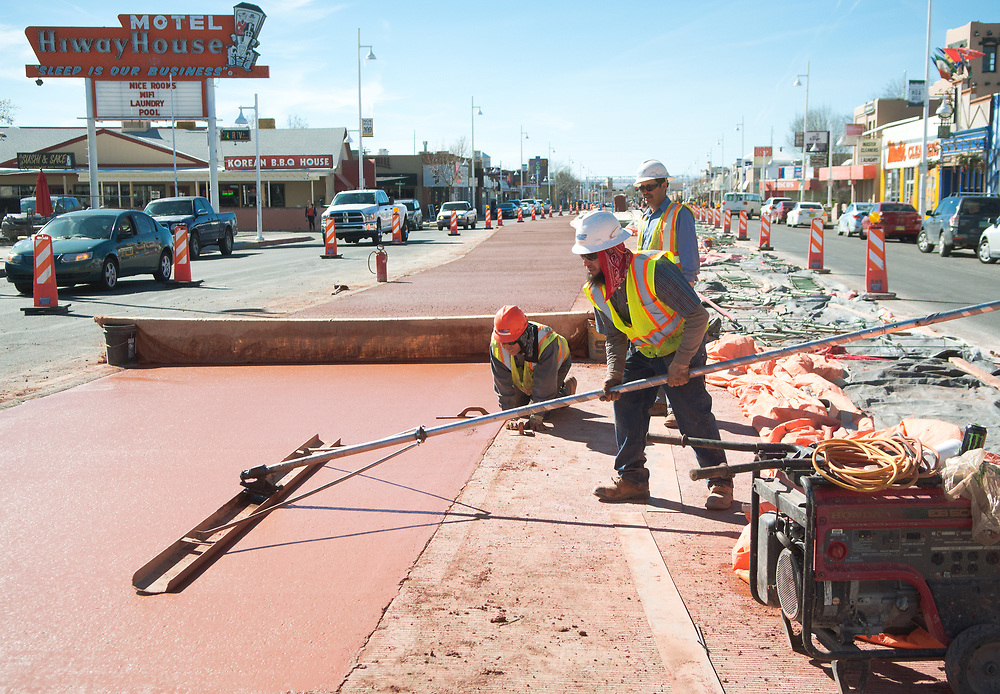 mkb030917/metro/Marla Brose  --  Construction workers work on Central Ave. ART construction in Nob Hill, Thursday, March 9, 2017. (Marla Brose/Albuquerque Journal)