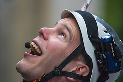 London, September 7th 2015. PICTURED: Darren Guidera of Team Brogan looks up at the dizzying height from which he has descended after abseiling down the face of the Leadenhall Building - popularly know as the Walkie Talkie Building. The Outward Bound Trust City Three Peaks Challenge in conjunction with The Royal Navy and Royal Marines Charity is a breathtaking abseiling endeavour on the greatest urban mountain range: The City of London.