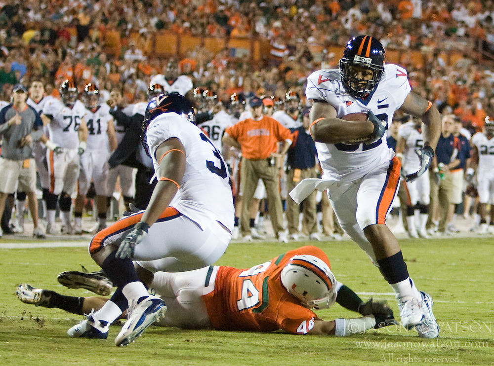 Virginia running back Keith Payne (32) cuts past Miami (FL) offensive lineman John Rochford (46) to score a touchdown.  The #19 Virginia Cavaliers defeated the Miami Hurricanes 48-0 at the Orange Bowl in Miami, Florida on November 10, 2007.  The game was the final game played in the Orange Bowl.