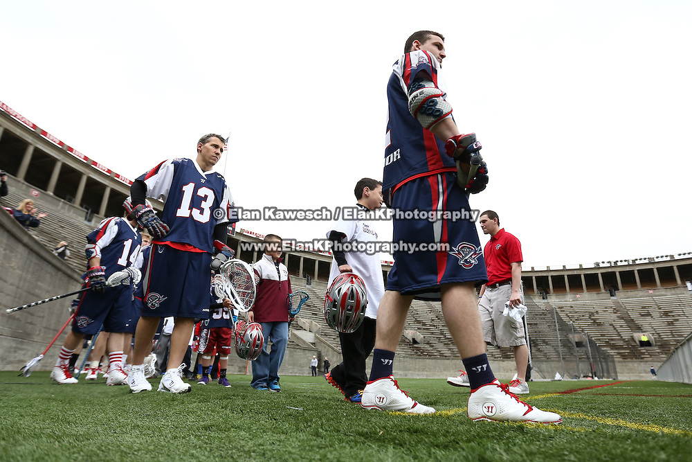 Eric Hagarty #13 of the Boston Cannons and other members of the Boston Cannons prepare to take the field prior to the game at Harvard Stadium on April 27, 2014 in Boston, Massachusetts. (Photo by Elan Kawesch)