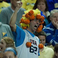 A Delaware fan wearing head dress made of mini basketballs chatting (Let's Go Hens) from the stands first half of a 2013 Round Two Women's NCAA tournament game against No. 3 North Carolina and No. 6 Delaware Tuesday, March 26, 2013, at the Bob Carpenter Center in Newark Delaware.
