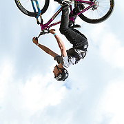 SHOT 7/29/11 2:58:47 PM - Anthony Messere, 15, gets inverted off a jump at Crankworx Colorado in the Trestle Bike Park at Winter Park, Co. Messere finished 18th after a surprise third place finish at Kokanee Crankworx. The event is a Pro-am mountain bike competition featuring a dual slalom race, the Trestle Unchained Challenge, slopestyle and cross country racing events where top pros competed for more than $35,000 in prize money. (Photo by Marc Piscotty / © 2011)