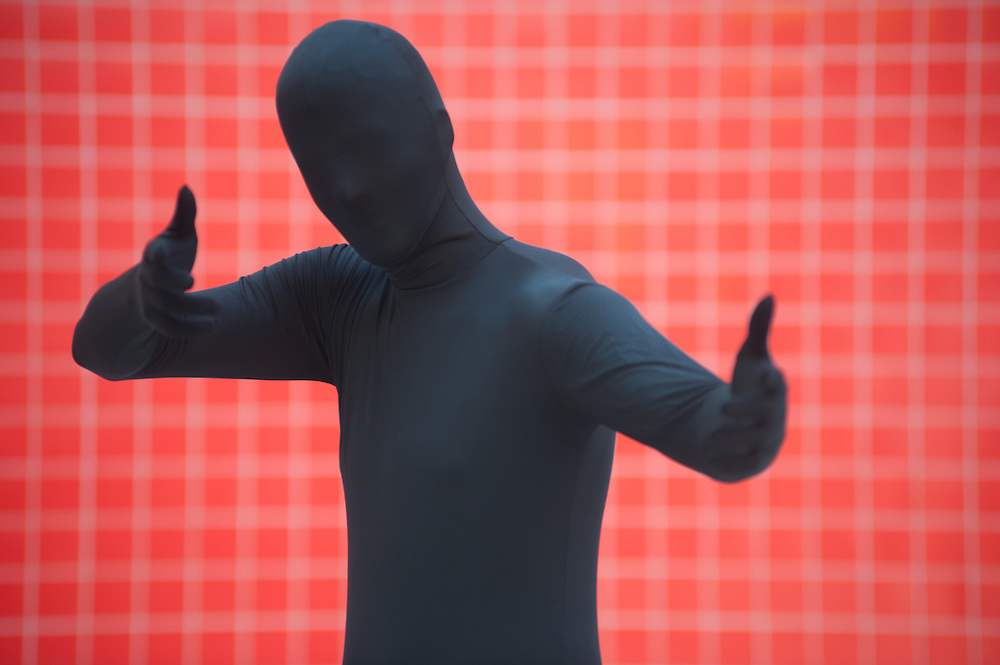 London, UK - 26 May 2013: William Silva dressed as Shadow man poses for a picture during the London Comic Con 2013 at Excel London. London Comic Con is the UK's largest event dedicated to pop culture attracting thousands of artists, celebrities and fans of comic books, animes and movie memorabilia.