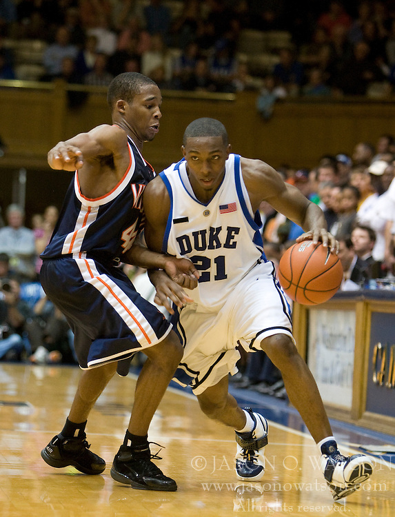 Duke guard DeMarcus Nelson (21) dribbles past Virginia guard Sean Singletary (44).  The Duke Blue Devils defeated the Virginia Cavaliers 87-65 in men's basketball at Cameron Indoor Stadium on the campus of Duke University in Durham, NC on January 13, 2008.