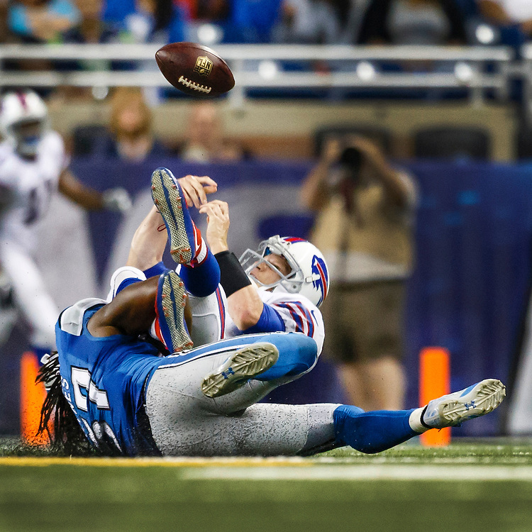 Detroit Lions linebacker Josh Bynes (57) cause Buffalo Bills quarterback Matt Simms (8) to fumble during an preseason NFL football game at Ford Field in Detroit, Thursday, Sept. 3, 2015. (AP Photo/Rick Osentoski)
