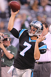 Aug 26, 2012; East Rutherford, NJ, USA; Carolina Panthers quarterback Jimmy Clausen (7) throws a pass during warmups for their game against the New York Jets at MetLife Stadium.