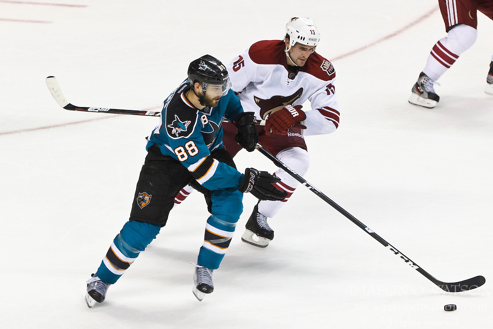 Mar 24, 2012; San Jose, CA, USA; San Jose Sharks defenseman Brent Burns (88) skates with the puck past Phoenix Coyotes center Boyd Gordon (15) during the third period at HP Pavilion.  San Jose defeated Phoenix 4-3 in shootouts. Mandatory Credit: Jason O. Watson-US PRESSWIRE