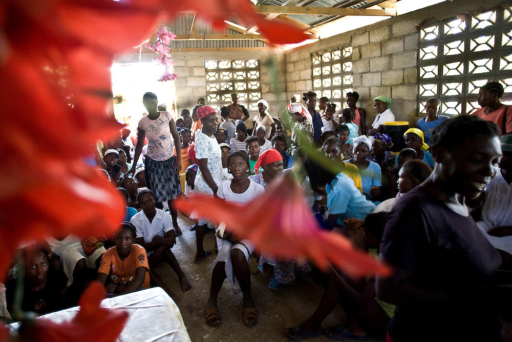 A group of Fonkoze microcredit clients meet together in a church at the beginning of their 18 month Path to a Better Life program.