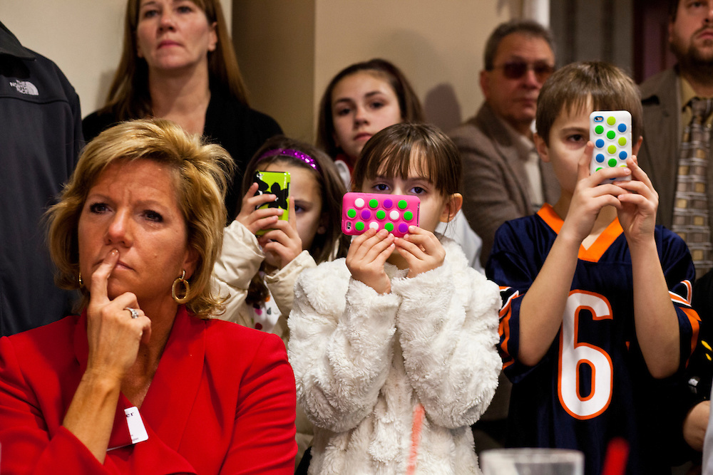 Children record videos of Republican presidential candidate Newt Gingrich as he speaks at a Rotary Club meeting on Tuesday, December 27, 2011 in Dubuque, IA.