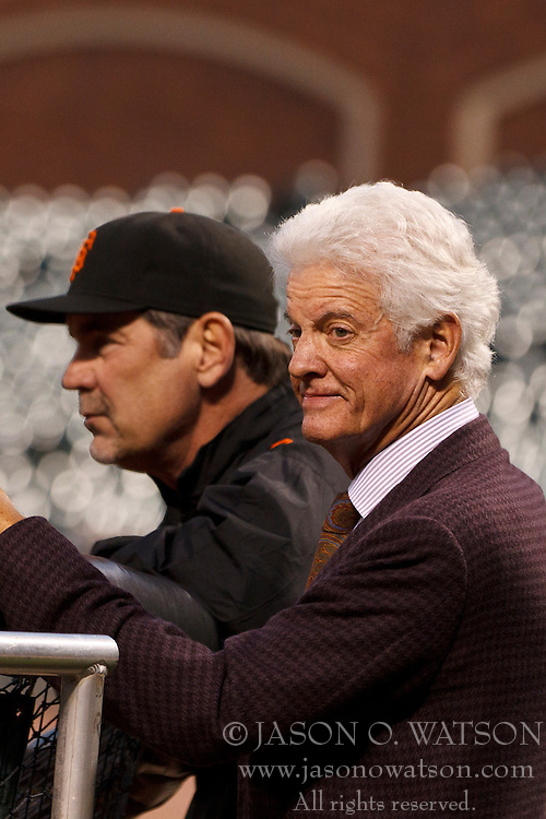 October 6, 2010; San Francisco, CA, USA; San Francisco Giants owner William Neukom (right) and manager Bruce Bochy (left) watch their team during practice the day before game one of the NLDS at AT&T Park.