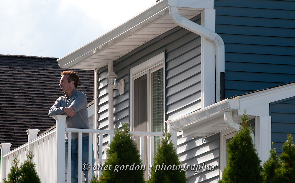 Craig Furer stands on a balcony outside the master bedroom of his Cranford, NJ home on Sunday, October 23, 2016. Furer and his wife Jen hired Magnolia Home Remodeling Group to complete a full exterior makeover. The company replaced the siding with shake and clapboard, added various architectural accents, replaced the roof, modified the roofline, built a front portico and replaced two windows. Craig spent a lot of time researching this project before it began and is thrilled with the overall result.  © Chet Gordon for Angie's List