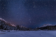 Night skies above Chugach Mountains and Eagle River Valley in Southcentral Alaska. Winter. Evening.