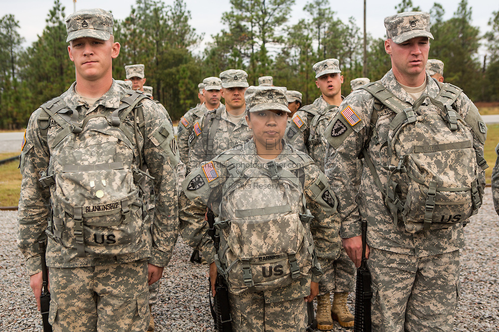 A women Drill Sergeant candidate stands with her male counterparts at the US Army Drill Instructors School Fort Jackson September 26, 2013 in Columbia, SC. While 14 percent of the Army is women soldiers there is a shortage of female Drill Sergeants.
