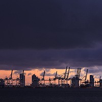 The port of Miami, Florida with Miami Beach condo buildings in the background, shortly before sunrise.