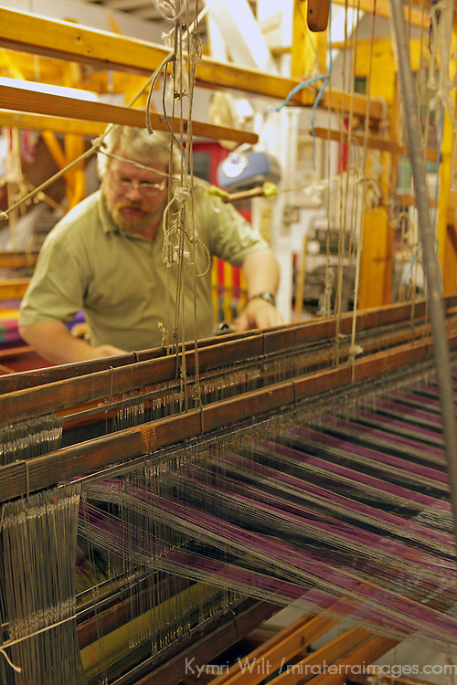 Europe, Ireland, Avoca. Avoca Handweavers Mill, County Wicklow. Weaver at woollen handweaving loom.